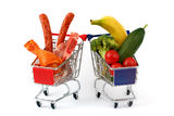 Meat and vegetables in two shopping carts, isolated on white Stock Image