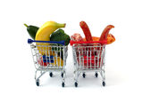 Meat and vegetables in two shopping carts, isolated on white Stock Photos