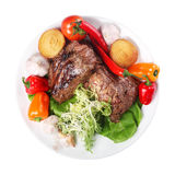 Meat with vegetables white background. Meat with vegetables on a plate on white background Royalty Free Stock Photo