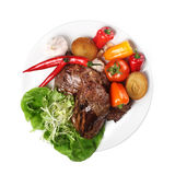 Meat with vegetables white background. Meat with vegetables on a plate on white background Stock Images