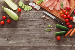 Meat and vegetables on  wooden table Stock Image