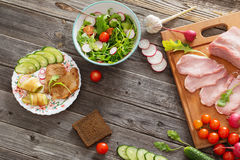 Meat and vegetables on  wooden table. Meat and vegetables on old wooden table Royalty Free Stock Photos