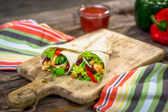 Meat and vegetables wrapped in a tortilla Stock Images