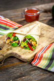 Meat and vegetables wrapped in a tortilla Royalty Free Stock Photos