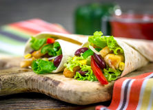 Meat and vegetables wrapped in a tortilla Royalty Free Stock Photo