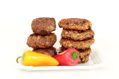 Meat vs. grain balls Royalty Free Stock Photography