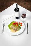 Meat and wine. Filletto al pepe verde and wine Royalty Free Stock Images