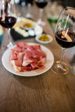 Meat and wineglass on table at bar Royalty Free Stock Photo