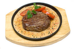 Meat on wooden plate Royalty Free Stock Photography