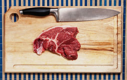 Meat on wooden table. Stock Images