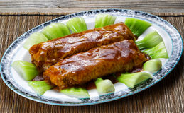 Meat wrapped in tofu with sauce and vegetables in serving plate Royalty Free Stock Photography