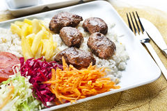 Meatball. Turkish meatballs served with vegetable, rice and french fries stock images