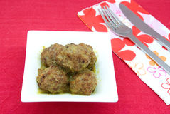 Meatball. S made with veal and pork with red wine sauce reduction royalty free stock photo