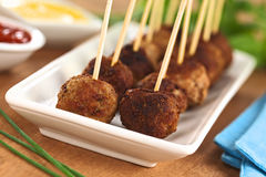 Meatball Appetizer. S with toothpicks and sauces on the side (Selective Focus, Focus on the first two meatballs Royalty Free Stock Photos