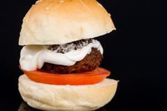 Meatball in a bun with tomato and mayonnaise Stock Images