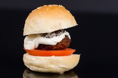 Meatball in a bun with tomato and mayonnaise Stock Image