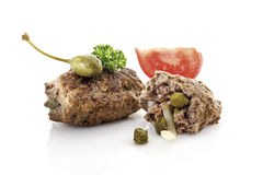 Meatball with caper fruit and parsley Stock Photos