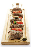 Meatball with caper fruit, tomato on a wooden tray Royalty Free Stock Photos