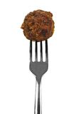 Meatball on fork. Meatball on a fork isolated over white Stock Photos