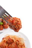Meatball on a fork and spaghetti Royalty Free Stock Photography