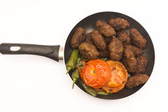 Meatball on frying pan Royalty Free Stock Image