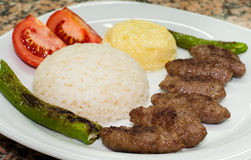 Meatball plate with rice and pepper. Meatball plate (Turkish kofte) with rice and pepper Stock Photos