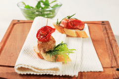Meatball and prosciutto canapes Stock Photos