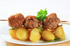 Meatball skewer and potatoes Royalty Free Stock Image