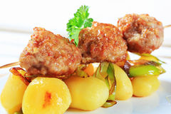 Meatball skewer and potatoes Royalty Free Stock Images