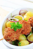 Meatball skewer and potatoes Royalty Free Stock Photography