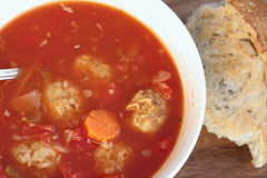 Meatball Soup. Delicious healthy Meatball Soup and bread. Soup is made with turkey meatball, but could also be used for traditional meatballs,beef and tomato Royalty Free Stock Photos