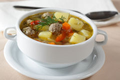 Meatball soup. With vegetables closeup Stock Images