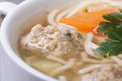 Meatball soup, noodles with vegetables Stock Images