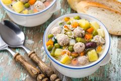 Meatball soup with vegetables Stock Images