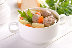Meatball soup in white bowl stock photo