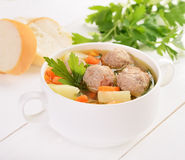 Meatball soup in white bowl royalty free stock image