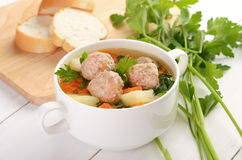 Meatball soup in white bowl royalty free stock photography
