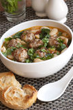 Meatball stew. Pork meatball stew with tomato, spinach and butterbeans Stock Photography