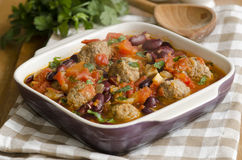 Meatball stew. Smoky Mexican meatball stew with beans and herbs Stock Photos