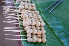 Meatball. Thai Street food ,Grill pork meatball on Banana leaf Royalty Free Stock Photos