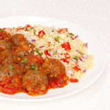 Meatball in Tomato Sauce with Couscous Royalty Free Stock Photography