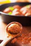 Meatball with tomato sauce in spoon Stock Photos