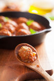 Meatball with tomato sauce in spoon Royalty Free Stock Image