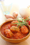 Meatball. With tomato sauce on the table Stock Images