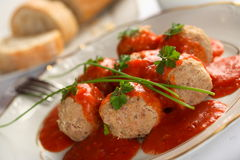 Meatball with tomatoes dressing Royalty Free Stock Photos