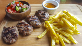 Meatball. Turkish meatballs served with vegetable and french fries Stock Image