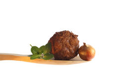 Meatball on a wooden spoon Stock Photography