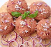 Meatballs. Some fresh, raw meatballs with onions Stock Images
