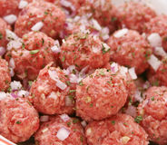 Meatballs. Some raw meatballs with spices and onions stock photo