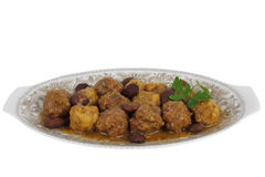 Meatballs with Almonds. Dish of meatball made with beef on almond sauce, presented in decorated porcelain plate royalty free stock photography